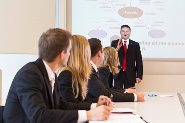 students studying in businessmanagement in modern classrooms with jeffrey martin