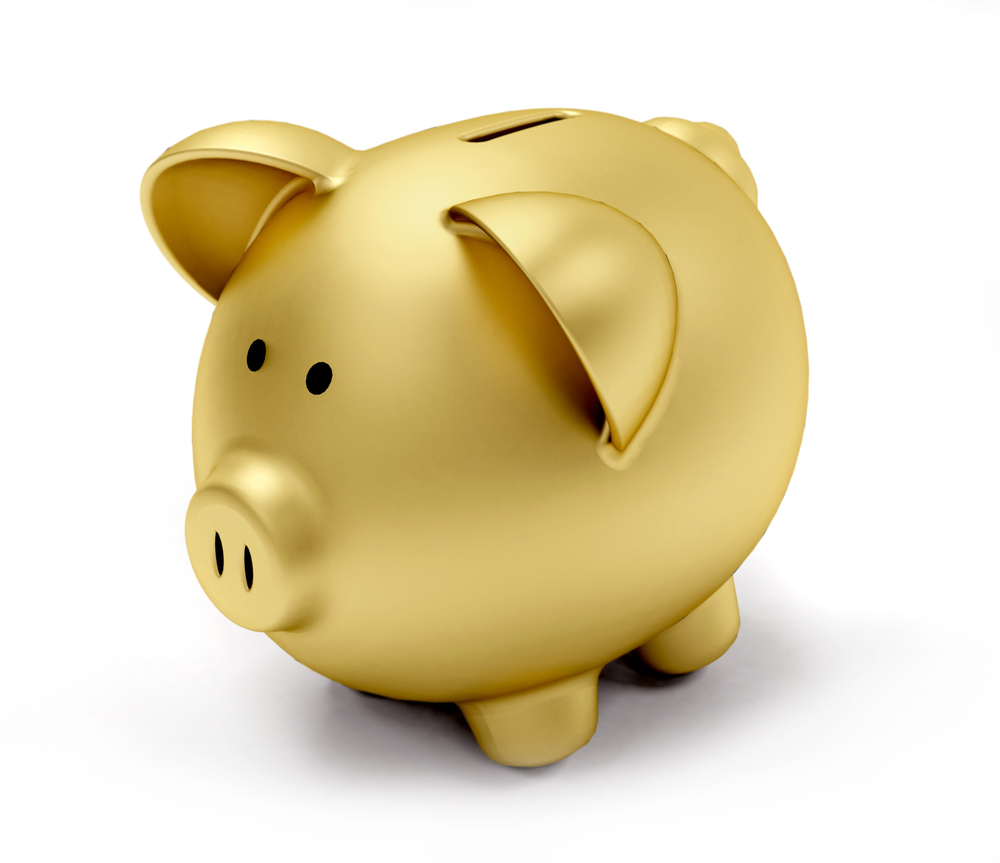 Golden piggy bank isolated over a white background